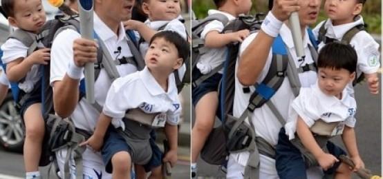 2014仁川亞運會火炬手進行火炬傳遞的宋一國以及可愛的三胞胎